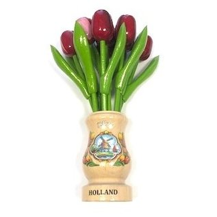 mixed red wooden tulips in a transparent wooden vase