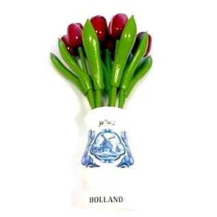 Mixed red wooden tulips in a white wooden vase