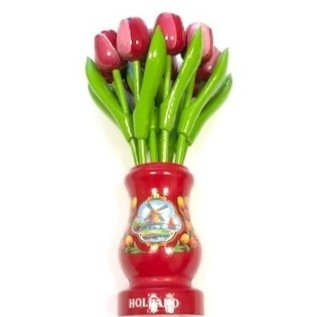 red-white wooden tulips in a red wooden vase