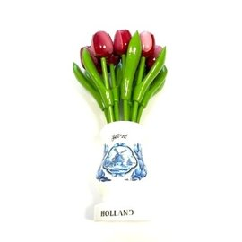 Red-white wooden tulips in a white wooden vase