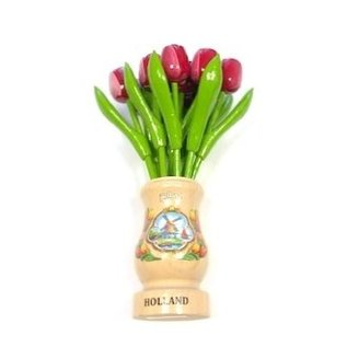 Red-white wooden tulips in a transparent wooden vase