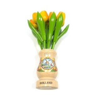 yellow wooden tulips in a transparent wooden vase