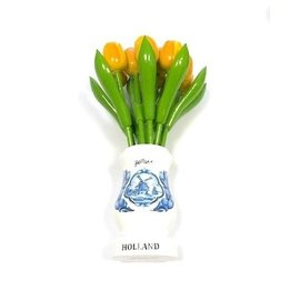 Yellow wooden tulips in a white wooden vase