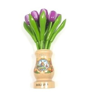 Purple wooden tulips in a transparent wooden vase