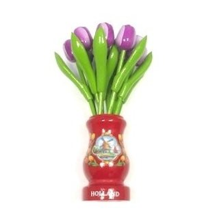 Purple wooden tulips in a red wooden vase