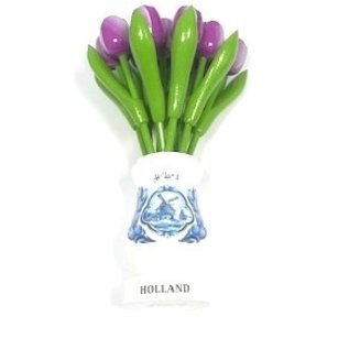 Purple wooden tulips in a white wooden vase