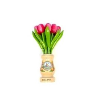 pink-white wooden tulips in a transparent wooden vase