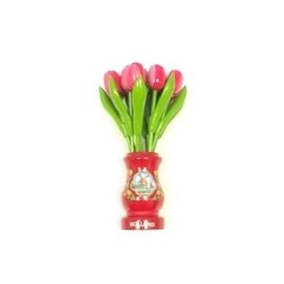 Pink-white wooden tulips in a red wooden vase