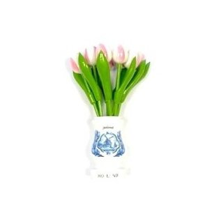 White-pink wooden tulips in a white wooden vase