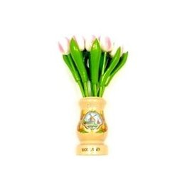 White-pink wooden tulips in a transparent wooden vase