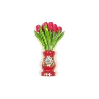 pink wooden tulips in a red wooden vase