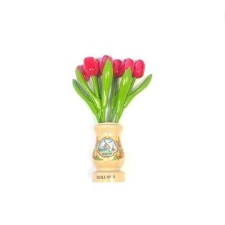 pink wooden tulips in a transparent wooden vase