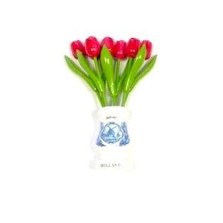 pink wooden tulips in a white wooden vase