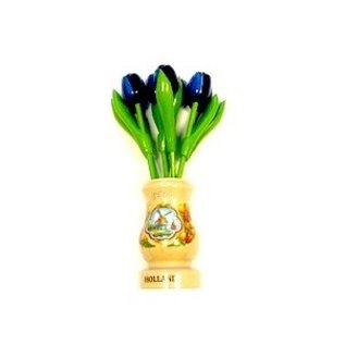 Blue wooden tulips in a transparent wooden vase