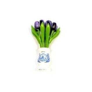 Dark purple wooden tulips in a white wooden vase