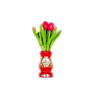 mixed pink wooden tulips in a red wooden vase