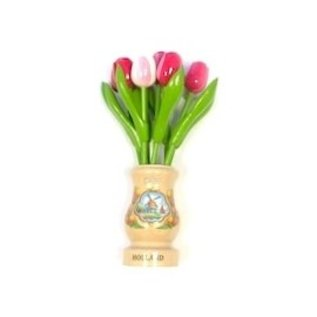 mixed pink wooden tulips in a transparent wooden vase