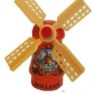 Oranje souvenirs molen op een magneet