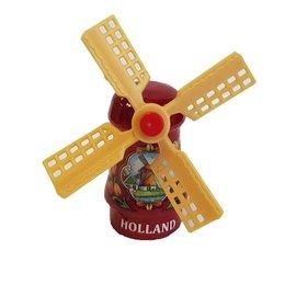 Rode souvenir molen op een magneet