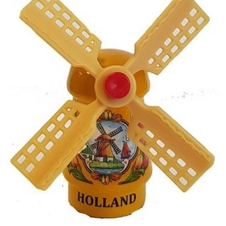 Yellow souvenir mill on a magnet