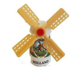 White souvenir mill on a magnet