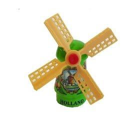 Green souvenir windmill on a magnet