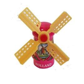 Pink souvenir windmill on a magnet