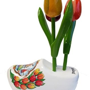 Wooden tulips on a wooden shoe with logo