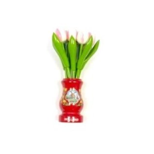 White-pink wooden tulips in a red wooden vase