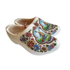 White wooden shoes with a windmill