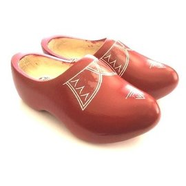 Red wooden shoes with piping