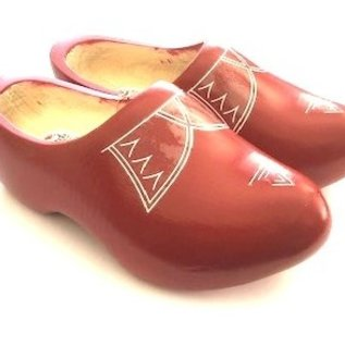 Red children's clogs with piping