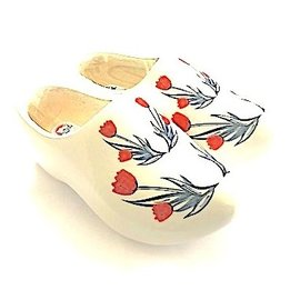 Dutch wooden shoes with red tulips