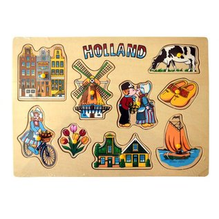 wooden puzzle board with Dutch pictures