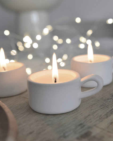 4 CLAY CANDLE HOLDERS WITH WAX