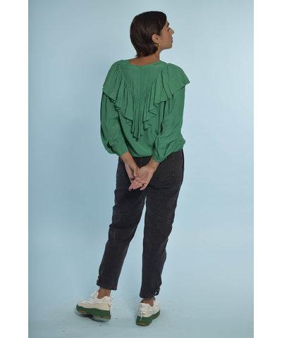 Groene Essentiel Antwerp look met grijze IRO broek