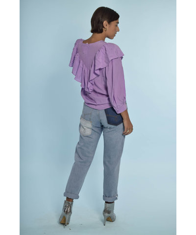 Lila blouse met een broek van Munthe