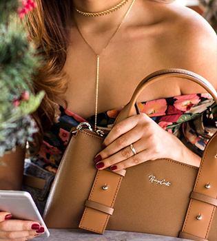 Brown leather handbag by Renzo Costa