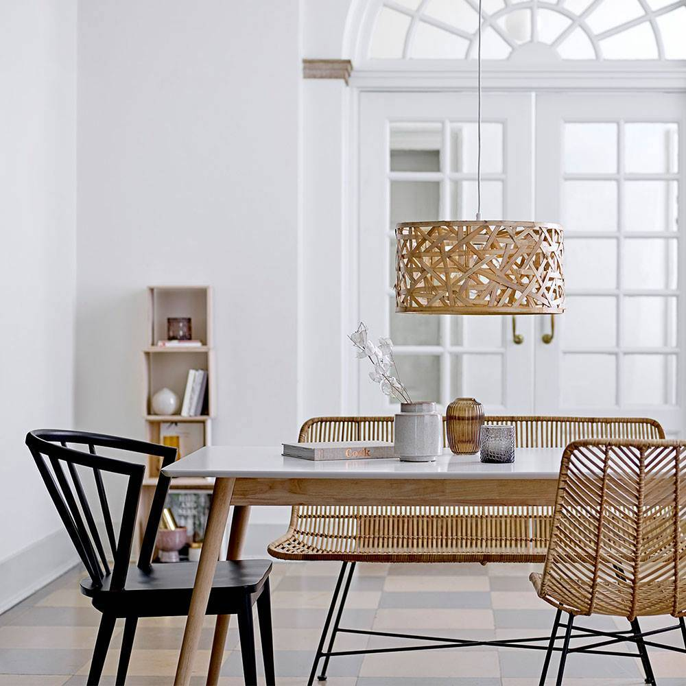 Picture perfect! The Bloomingville natural rattan bench and chair are the most elegant in it's kind and they do magic around the dining table of this gorgeous classic dining room.