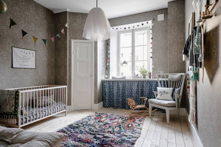 A Scandinavian base, Vintage and retro furniture, floral wallpaper, soft ethnic element and a touch of dusty pink - seen at interiorjunkie.com