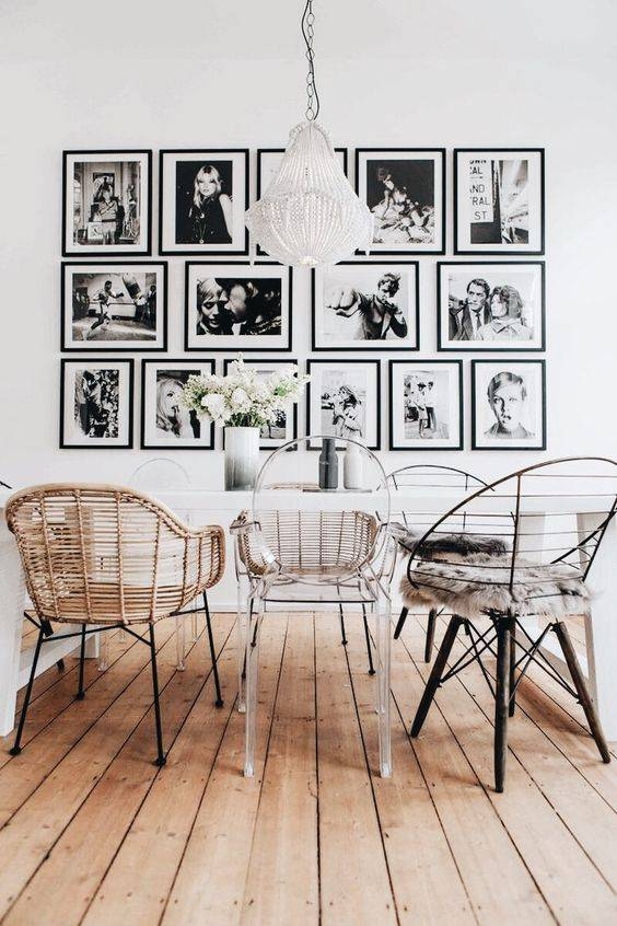 A playful mix of chairs and photo frames and an original light fixture that fits your personal taste! - seen at Pinterest
