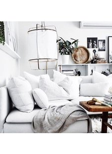 A clean, white decor, with warm characteristic unique pieces and comfy soft textile