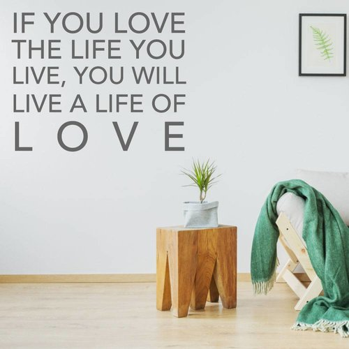 Muurtekst if you love the life you live, you will live a life of love