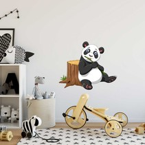 Muursticker pandabeer bij boomstam