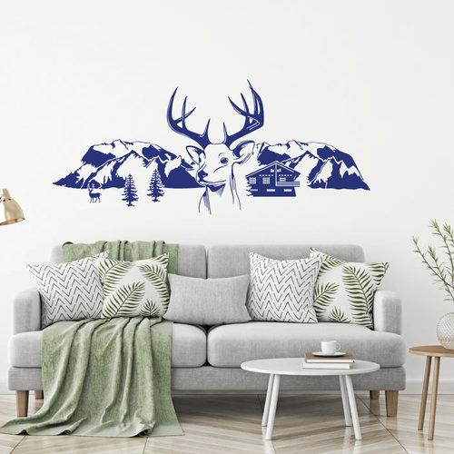 Muursticker Herten met bergen bomen en huis