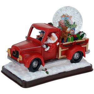Kerstman met sneeuwbol in pickup truck