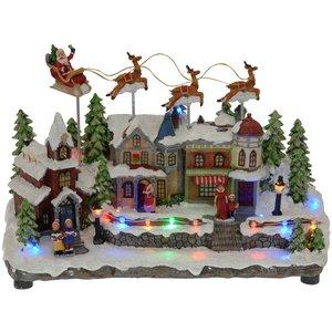 Kersttafereel met bewegende arreslee