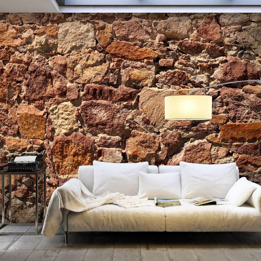 Fotobehang - Muur van aarde kleurige grote keien , rood bruin