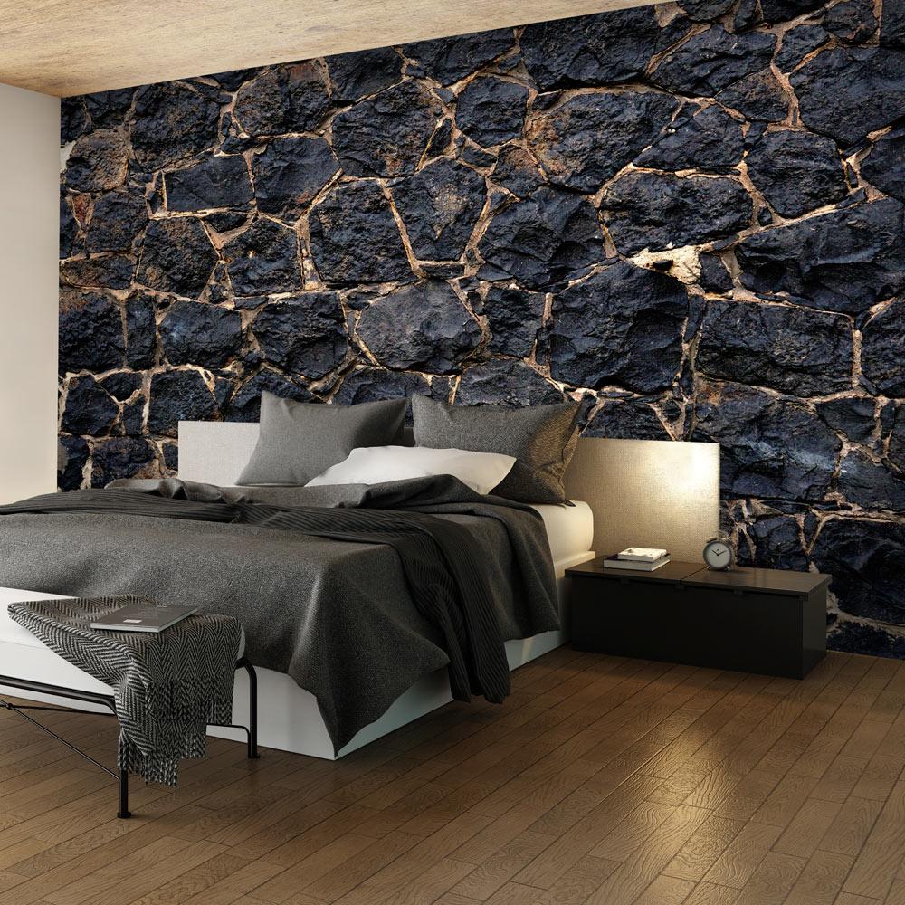 Fotobehang -Muur van zwarte rotsblokken