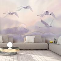 Fotobehang - Vliegende Zwanen, premium print vliesbehang